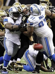 National-football-league-2011-season-week-13-drew-brees-sammie-lee-hill-nfl-1112-wk13-00511md_medium