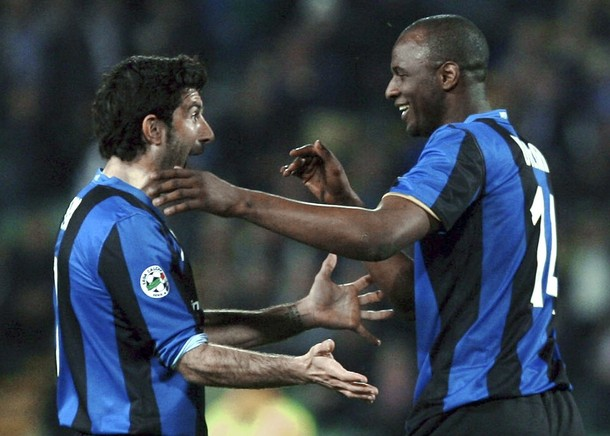 Vieira and Figo congratulate each other on still being in the game