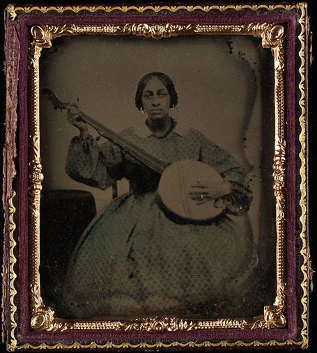 538px-portrait_of_a_young_black_woman_2c_seated_2c_holding_nine_string_banjo_medium