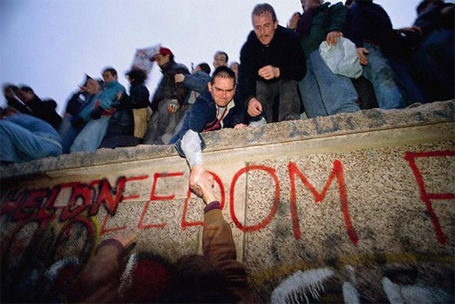 1989-11-09_people_freed_from_communist_east_germany_for_first_time_in_40_years_as_the_berlin_wall_is_torn_down_november_11_1989_medium