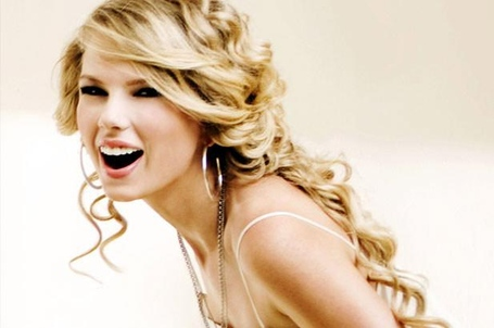 1235479-taylor-swift-woman-of-the-year-617-409_medium