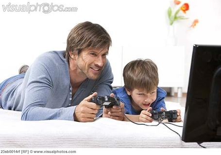 Father_and_son_playing_a_video_game_23sb0014rf_medium