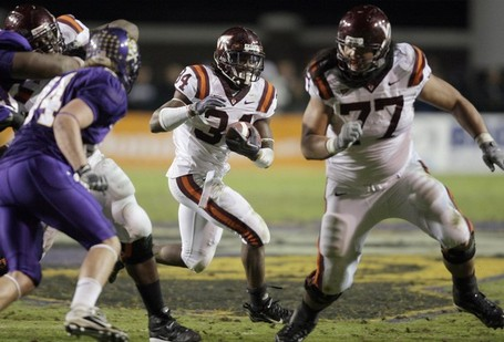 Virginia-tech_s-ryan-williams-34-gets-a-block-from-ed-wang-77-as-east-carolina_s-nick-johnson-left-tries-to-make-the-stop-during-thursday_s-game_medium