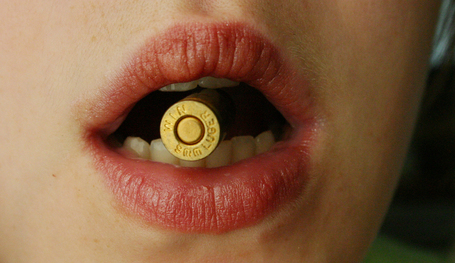 Bite_the_bullet_by_della_stock_medium