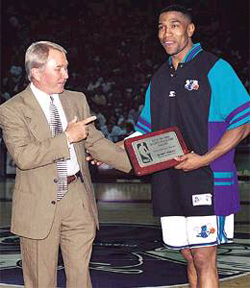 112-george-shinn-congratulates-bobby-phills-on-winning-the-nbas-central-division-sportsmanship-award-in-1998_medium