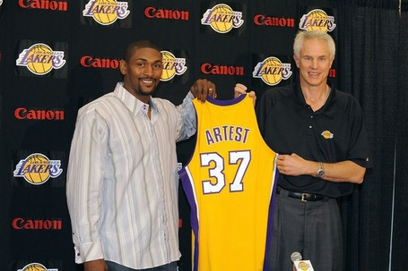 Ron_artest_hold_up_his_new_lakers_jersey_with_mitch_kupchak_medium