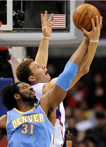 Blake_griffin_battles_nene_for_the_rebound_medium