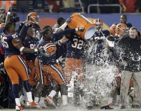 Syracuse-players-douse-coach-doug-marrone-after-syracuse-defeated-kansas-state-36-34-in-the-inaugural-pinstripe-bowl-ncaa-college-football-game-at-yankee-stadium-on-thursday-dec-rf_107477_medium