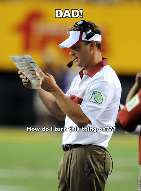 Lane Kiffin with a playcard