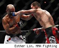 Nick Diaz punches B.J. Penn at UFC 137.