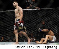 Carlos Condit walks off after knocking out Dong Hyun Kim, UFC 132