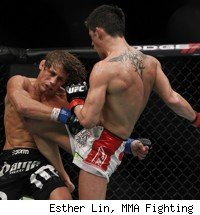 Dominick Cruz knees Urijah Faber at UFC 132.