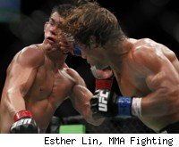 Urijah Faber punches Dominick Cruz at UFC 132.