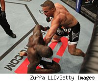 Pat Barry knocks down Cheick Kongo in the first round of their match Sunday night.
