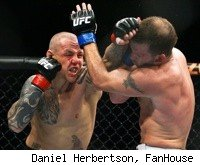 Ross Pearson punches Spencer Fisher at UFC 127.