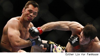 Forrest Griffin punches Rich Franklin at UFC 126