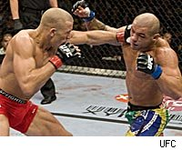 Georges St. Pierre punches Thiago Alves