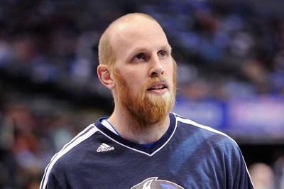 Chris Kaman takes a seat mid-post-move