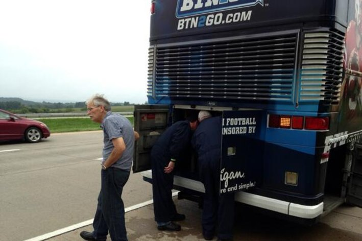 Big Ten Network tour bus breaks down on side of road.