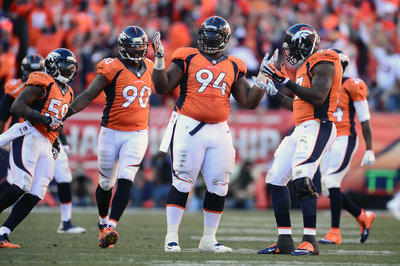 Terrance 'Pot Roast' Knighton gives his #94 Broncos jersey number to DeMarcus Ware