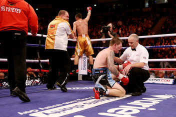 Senchenko celebrates a career-best victory while Hatton looks on from the canvas.